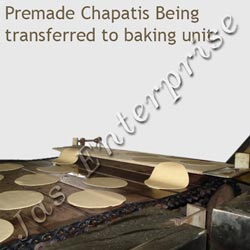 Pre-mad chapati being transfered to backing units